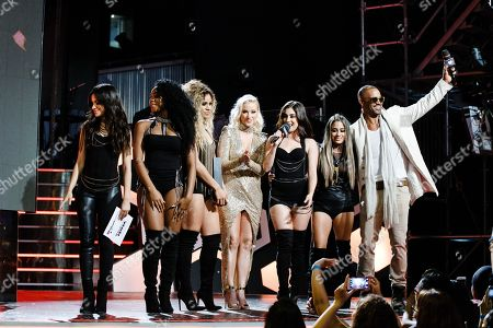 Members of Fifth Harmony, Liz Trinnear, center, and Shemar Moore, right, speak at the 2016 iHeartRadio MuchMusic Video Awards, in Toronto