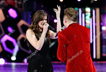 Shawn Hook, right, and Hailee Steinfeld perform at the 2016 iHeartRadio MuchMusic Video Awards, in Toronto