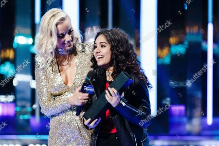 Liz Trinnear, left, and Alessia Cara appear onstage at the 2016 iHeartRadio MuchMusic Video Awards, in Toronto
