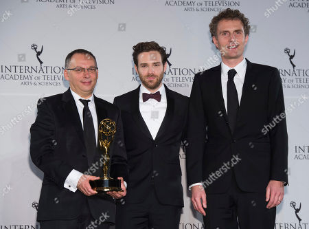 Derek Wax, left, Ben Rappaport and Euros Lyn appear in the press room at the 44th International Emmy Awards at the New York Hilton, in New York