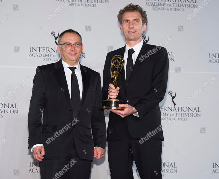 Stock Photo of Derek Wax, left, and Euros Lyn appear in the press room at the 44th International Emmy Awards at the New York Hilton, in New York