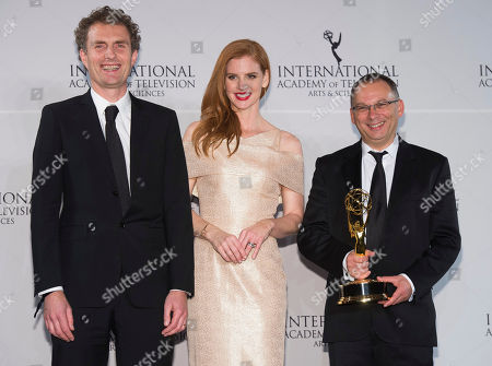 Stock Image of Derek Wax, left, Sarah Rafferty and Euros Lyn appear in the press room at the 44th International Emmy Awards at the New York Hilton, in New York
