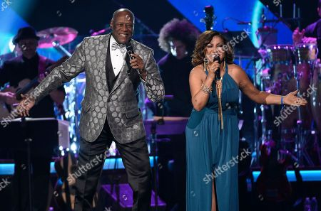 "Johnny Ventura, left, and Milly Quezada perform ""Tu Amor Me Hace Bien"" at the Latin Recording Academy Person of the Year Tribute honoring Marc Anthony at the MGM Grand Garden Arena, in Las Vegas"
