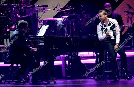 "Stock Picture of Julio Reyes Copello, left, and Prince Royce perform ""Cambio De Piel"" at the Latin Recording Academy Person of the Year Tribute honoring Marc Anthony at the MGM Grand Garden Arena, in Las Vegas"