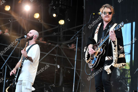 Sam Harris, left, and X Ambassadors is joined on stage by Jamie N Commons, on day 3 at Lollapalooza in Grant Park, in Chicago