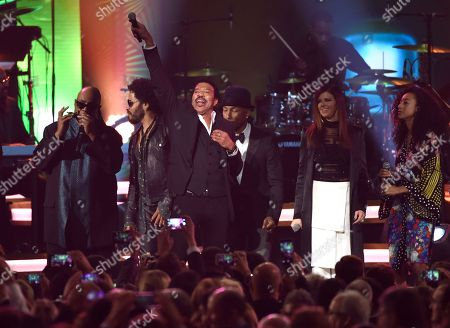 Honoree Lionel Richie performs at the MusiCares Person of the Year tribute at the Los Angeles Convention Center on . Pictured from left are Stevie Wonder, Lenny Kravitz, Pharrell Williams, Karen Fairchild and Corinne Bailey Rae
