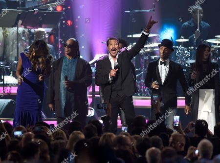 Honoree Lionel Richie performs at the MusiCares Person of the Year tribute at the Los Angeles Convention Center on . Pictured from left are Yolanda Adams, Stevie Wonder, Pharrell Williams and Karen Fairchild