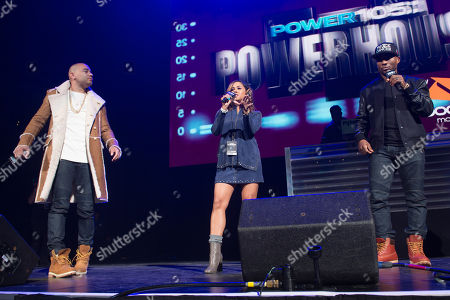 DJ Envy, left, Angela Yee, center, and Charlamagne Tha God of The Breakfast Club are seen on stage at Power 105.1's Powerhouse 2016 at Barclays Center, in Brooklyn, New York