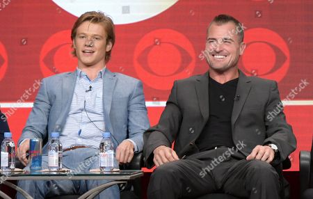 Lucas Till, left, and George Eads participate in the 'MacGyver' panel during the CBS Television Critics Association summer press tour, in Beverly Hills, Calif