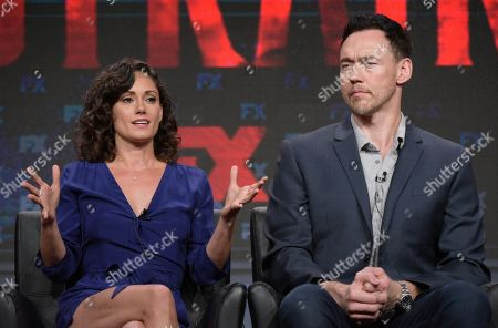 "Natalie Brown, left, and Kevin Durand participate in ""The Strain"" panel during the FX Television Critics Association summer press tour, in Beverly Hills, Calif"