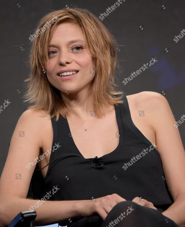 """Lizzie Brochere participates in USA network's """"Falling Water"""" panel during the NBCUniversal Television Critics Association summer press tour, in Beverly Hills, Calif"""