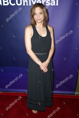 """Lizzie Brochere, a cast member in the television series """"Falling Water,"""" arrives at the NBCUniversal Television Critics Association summer press tour, in Beverly Hills, Calif"""