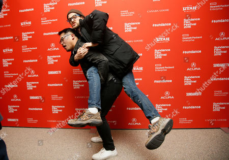 """Director and writer Daniel Scheinert, right, jumps on the back of fellow director and writer Dan Kwan, left, at the premiere of """"Swiss Army Man"""" during the 2016 Sundance Film Festival, in Park City, Utah"""