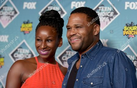 Kyra Anderson, left, and Anthony Anderson pose in the press room at the Teen Choice Awards at the Forum, in Inglewood, Calif