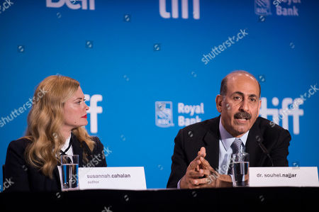 """Susannah Cahalan, left, and Dr. Souhel Najjar speak during the press conference for """"Brain on Fire"""" on day 9 of the Toronto International Film Festival at the TIFF Bell Lightbox, in Toronto"""