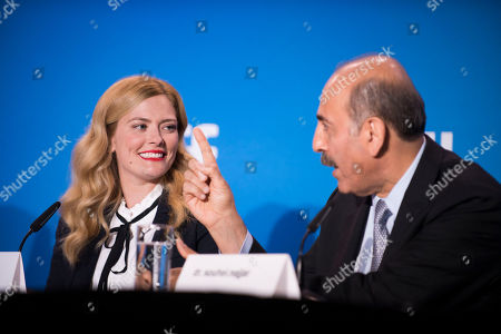 """Susannah Cahalan, left, and Dr. Souhel Najjar attend the press conference for """"Brain on Fire"""" on day 9 of the Toronto International Film Festival at the TIFF Bell Lightbox, in Toronto"""