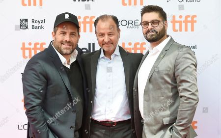 Producer Brett Ratner, from left, director Fisher Stevens and Tim Pastore, president, original programming & production, National Geographic Channel, arrive at the Before the Flood premiere on day 2 of the Toronto International Film Festival at the Princess of Wales Theatre, in Toronto