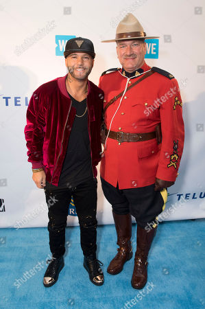 Karl Wolf, left, and RCMP Constable Terry Russel arrive at WE Day, in Toronto