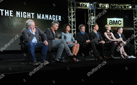 """Executive producers Simon Cornwell, from left, and Stephen Garrett, director/executive producer Susanne Bier, Hugh Laurie, Tom Hiddleston, Elizabeth Debicki and Tom Hollander participate in a panel for """"The Night Manager"""" during the AMC 2016 Winter TCA, in Pasadena, Calif"""