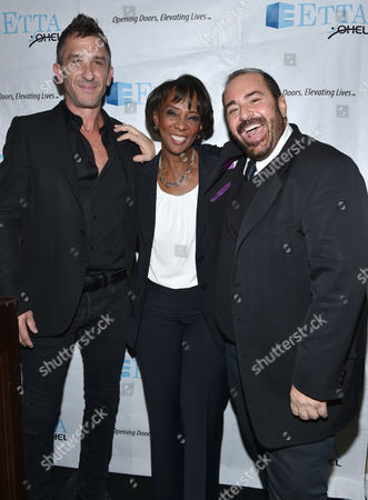 Davis Factor, from left, Jackie Lacey, Los Angeles District Attorney, and Michael Baruch attend the 21st Annual ETTA Gala held at The Beverly Hilton, in Beverly Hills, Calif