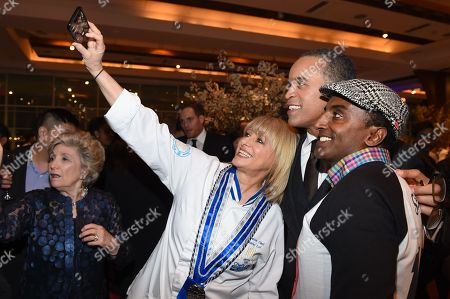 Chef Maria Loi, left, anchorman Maurice Dubois, center, and chef Marcus Samuelsson take a selfie at the 25th Anniversary Benefit for Careers through Culinary Arts Program (C-CAP) at Pier Sixty, in New York