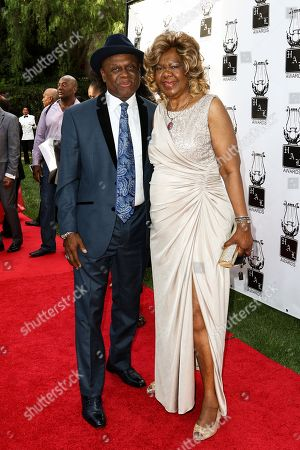 Stock Photo of Michael Colyar, left, and Janie Bradford attend the 26th Annual Heroes and Legends Awards held at The Beverly Hills Hotel, in Beverly Hills, Calif