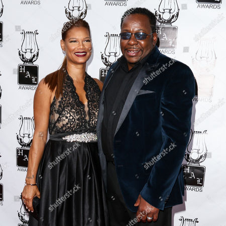 Stock Photo of Bobby Brown, right, and Alicia Etheridge attend the 26th Annual Heroes and Legends Awards held at The Beverly Hills Hotel, in Beverly Hills, Calif