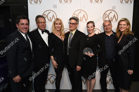EXCLUSIVE -Stewart A. Lyons, from left, Mark Johnson, Moira Walley-Beckett, Peter Gould, Melissa Bernstein, Thomas Schnauz, and Michelle MacLaren pose with the Norman Felton award for outstanding producer of episodic television drama for Breaking Bad at the 26th Annual Producers Guild Awards at the Hyatt Regency Century Plaza, in Los Angeles
