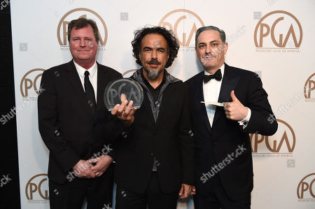 James W. Skotchdopole, and from left, Alejandro Gonzalez Inarritu, and John Lesher pose with the Darryl F. Zanuck Award for outstanding producer of theatrical motion pictures for Birdman at the 26th Annual Producers Guild Awards at the Hyatt Regency Century Plaza, in Los Angeles