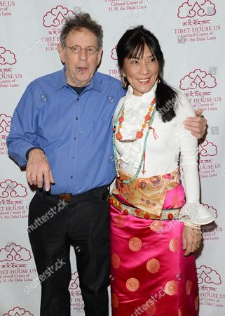 Stock Image of Composer Philip Glass, left, and musician Dechen Shak-Dagsay attend the 26th Annual Tibet House Benefit Gala after party at Gotham Hall, in New York