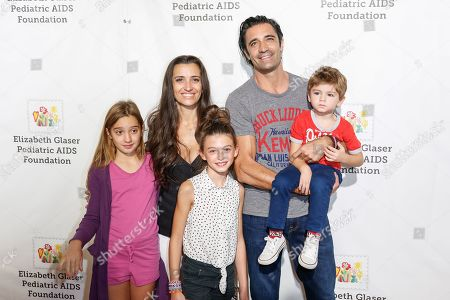 """Gilles Marini, top right, and Carole Marini, top left, arrive at the 27th Annual """"A Time for Heroes"""" Family Festival, in Culver City, Calif"""