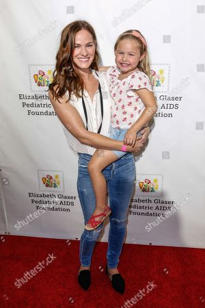 """Stock Image of Kelly Overton, left, arrives at the 27th Annual """"A Time for Heroes"""" Family Festival, in Culver City, Calif"""