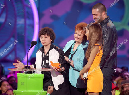 Stock Photo of From left, Cameron Ocasio, Maree Cheatham, Ariana Grande, and Zoran Korach accept the award for favorite TV show for Sam & Cat at the 27th annual Kids' Choice Awards at the Galen Center, in Los Angeles
