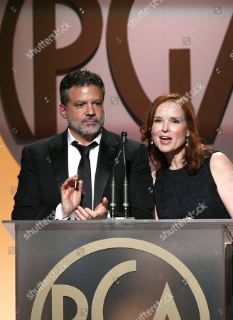 PGA Chairs Michael De Luca, left, and Jennifer Todd speak on stage at the 27th annual Producers Guild Awards at the Hyatt Regency Century Plaza, in Los Angeles