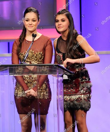 Hayley Orrantia, left, and Amber Montana present the award for best young actor/television on stage at the 29th annual Imagen Awards at the Beverly Hilton Hotel, in Beverly Hills, Calif