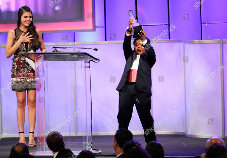 "Benjamin ""lil-P-Nut"" Flores Jr. accepts the award for best young actor/television for The Haunted Hathaways on stage at the 29th annual Imagen Awards at the Beverly Hilton Hotel, in Beverly Hills, Calif. Looking on from left Amber Montana"