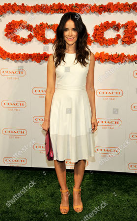 Stock Image of Actress Abigail Spencer poses at the 3rd Annual Coach Evening to Benefit Children's Defense Fun at Bad Robot on in Santa Monica, Calif