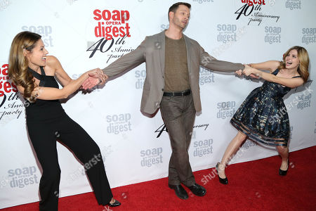 Marie Wilson, Eric Martsolf and Jen Lilley play around on the red carpet during the 40th Anniversary of Soap Opera Digest at The Argyle Hollywood, in Los Angeles