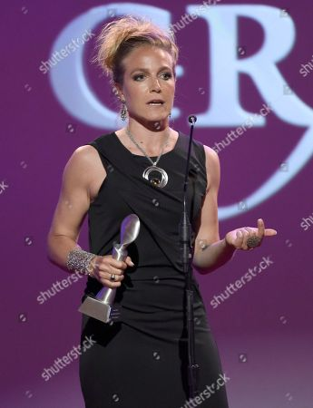 Stock Photo of Arwa Damon accepts the award for outstanding reporter/correspondent for CNN International at the 41st annual Gracie Awards Gala at the Beverly Wilshire Hotel, in Beverly Hills, Calif