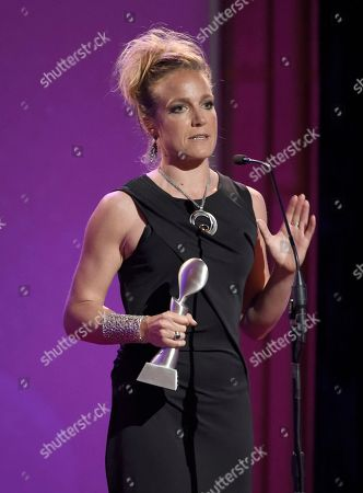 Stock Image of Arwa Damon accepts the award for outstanding reporter/correspondent for CNN International at the 41st annual Gracie Awards Gala at the Beverly Wilshire Hotel, in Beverly Hills, Calif