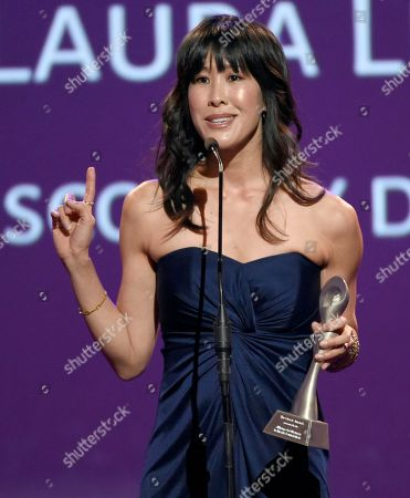 Laura Ling accepts the award for best online video host/correspondent for Discovery Digital Networks at the 41st annual Gracie Awards Gala at the Beverly Wilshire Hotel, in Beverly Hills, Calif