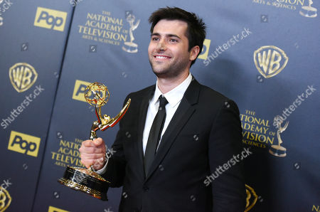 Stock Picture of Freddie Smith poses in the pressroom with the award for outstanding younger actor in a drama series at the 42nd annual Daytime Emmy Awards at Warner Bros. Studios, in Burbank, Calif