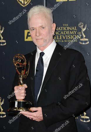 Stock Image of Anthony Geary poses in the pressroom with the award for outstanding lead actor in a drama series for General Hospital at the 42nd annual Daytime Emmy Awards at Warner Bros. Studios, in Burbank, Calif