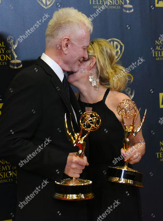 Stock Image of Anthony Geary, left, and Maura West pose in the pressroom with the award for outstanding lead actor and actress in a drama series at the 42nd annual Daytime Emmy Awards at Warner Bros. Studios, in Burbank, Calif