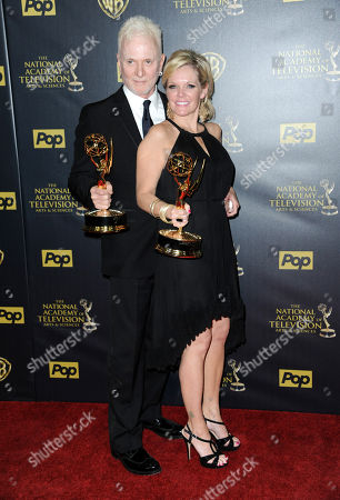 Stock Photo of Anthony Geary, left, and Maura West pose in the pressroom with the award for outstanding lead actor and actress in a drama series at the 42nd annual Daytime Emmy Awards at Warner Bros. Studios, in Burbank, Calif