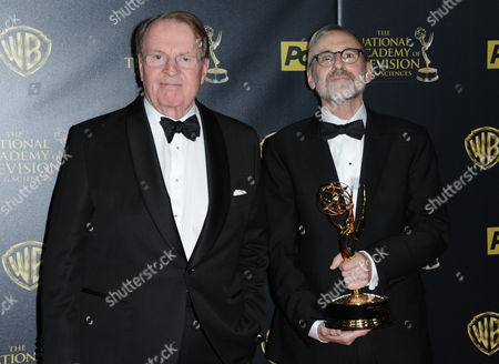 Charles Osgood, left, and Rand Morrison pose in the pressroom with the award for outstanding morning program for CBS Sunday Morning at the 42nd annual Daytime Emmy Awards at Warner Bros. Studios, in Burbank, Calif