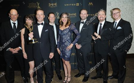 """Mike Richards, left, and the cast and crew of """"The Price is Right"""" pose in the pressroom with the award for outstanding game show for The Price is Right at the 43rd annual Daytime Emmy Awards at the Westin Bonaventure Hotel, in Los Angeles"""