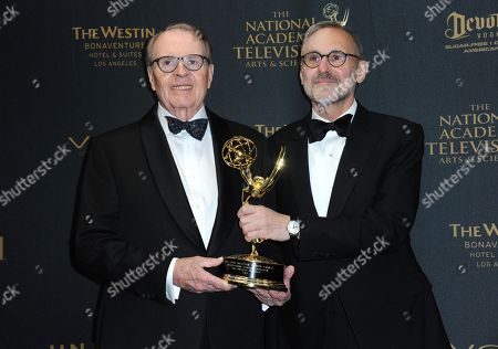 Charles Osgood, left, and Rand Morrison pose in the press room with the award for outstanding morning program for CBS Sunday Morning at the 43rd annual Daytime Emmy Awards at the Westin Bonaventure Hotel, in Los Angeles