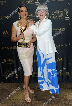 Sonia Manzano, winner of the Lifetime Achievement Award, left, and Rita Moreno pose in the press room at the 43rd annual Daytime Emmy Awards at the Westin Bonaventure Hotel, in Los Angeles