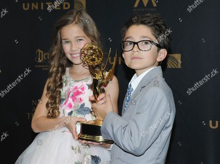 Brooklyn Rae Silzer, left, and Nicolas Bechtel pose in the pressroom with the award for outstanding drama series for General Hospital at the 43rd annual Daytime Emmy Awards at the Westin Bonaventure Hotel, in Los Angeles